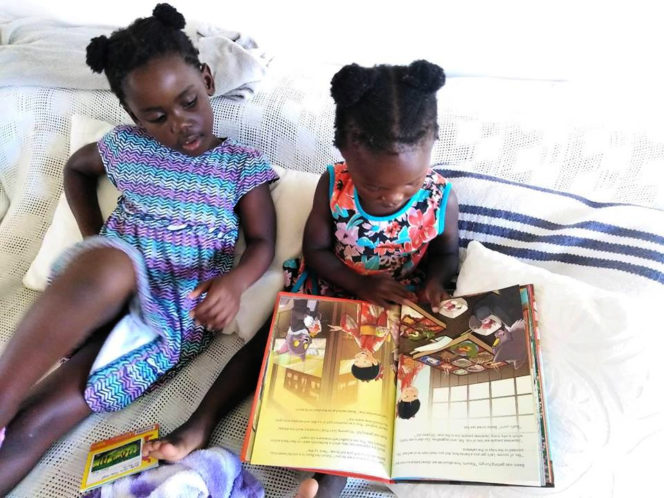 Girls reading Beato Goes To Japan